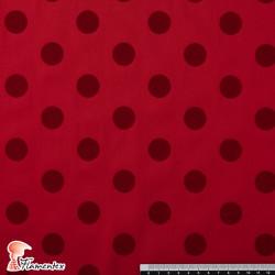 MADISON FLOSAR D/10. Tela satinada elástica con lunares flocados, perfecta para trajes de flamenca muy entallados.