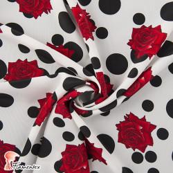 NATASHA. Tela de crespón con mucha caída, perfecta para trajes de flamenca. Estampado lunar irregular y rosa.