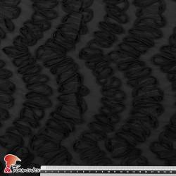 TUJENA. Tejido adornado con cintas de tela.